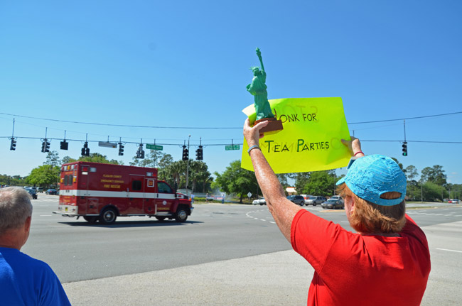 A tea party faithful at a rally in Palm Coast last year. The appearance of a Flagler County Fire Rescue unit in the picture in no way suggests Fire Rescue's endorsement of the tea party. (© FlaglerLive)