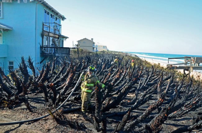 The charred backyard at 3431 North Ocean Shore. The fire consumed about one acre. The house was under renovation. Click on the image for larger view. (© FlaglerLive)