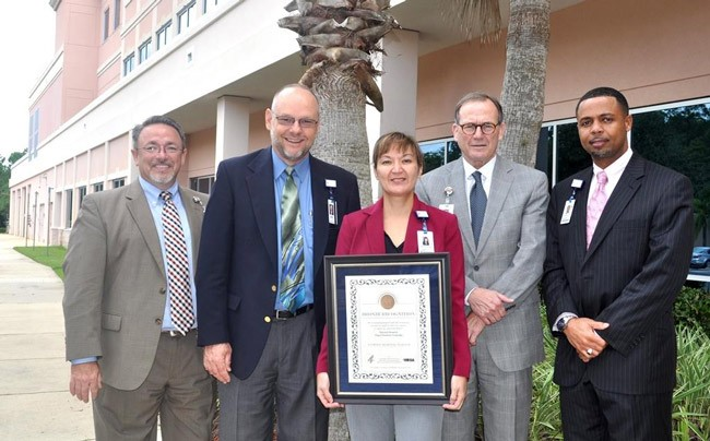 On Oct. 6, Florida Hospital Flagler was recognized by the U.S. Department of Health and Human Services (HHS) for conducting activities that promoted enrollment in state organ donor registries. From left, Florida Hospital Flagler leaders include  chief nursing officer Robert Davis; chief executive officer Ken Mattison; chief operating officer JoAnne King; chief medical officer Dr. Ronald Thomas; and chief financial officer Jermaine Bucknor.  See below for details.