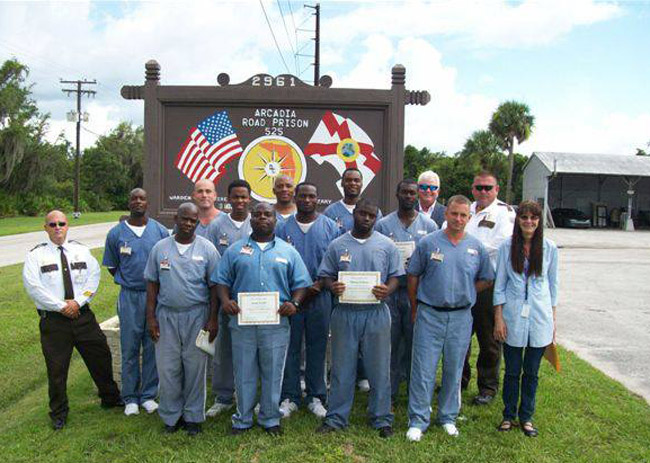 Soon they'll be holding up fashion certificates. (Florida Department of Corrections)
