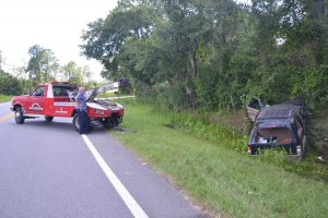 Jimmy Flynto, owner of Saxon's Towing, at the scene of a wreck. Click on the image for larger view. (© FlaglerLive)