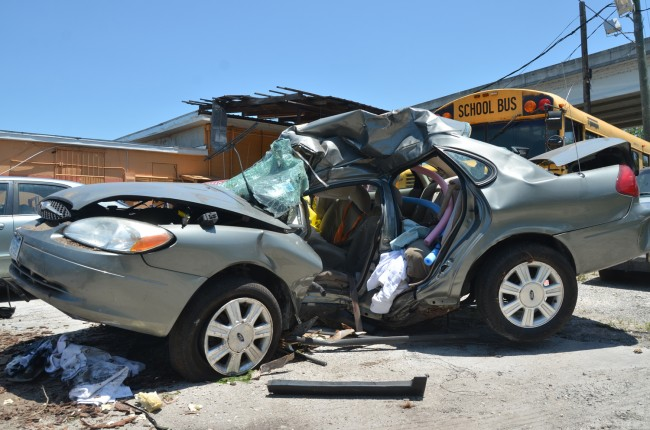 The Ford Taurus after it was towed from the scene. The tree it struck left a deep impact on the driver's side door. Click on the image for larger view. (c FlaglerLive)