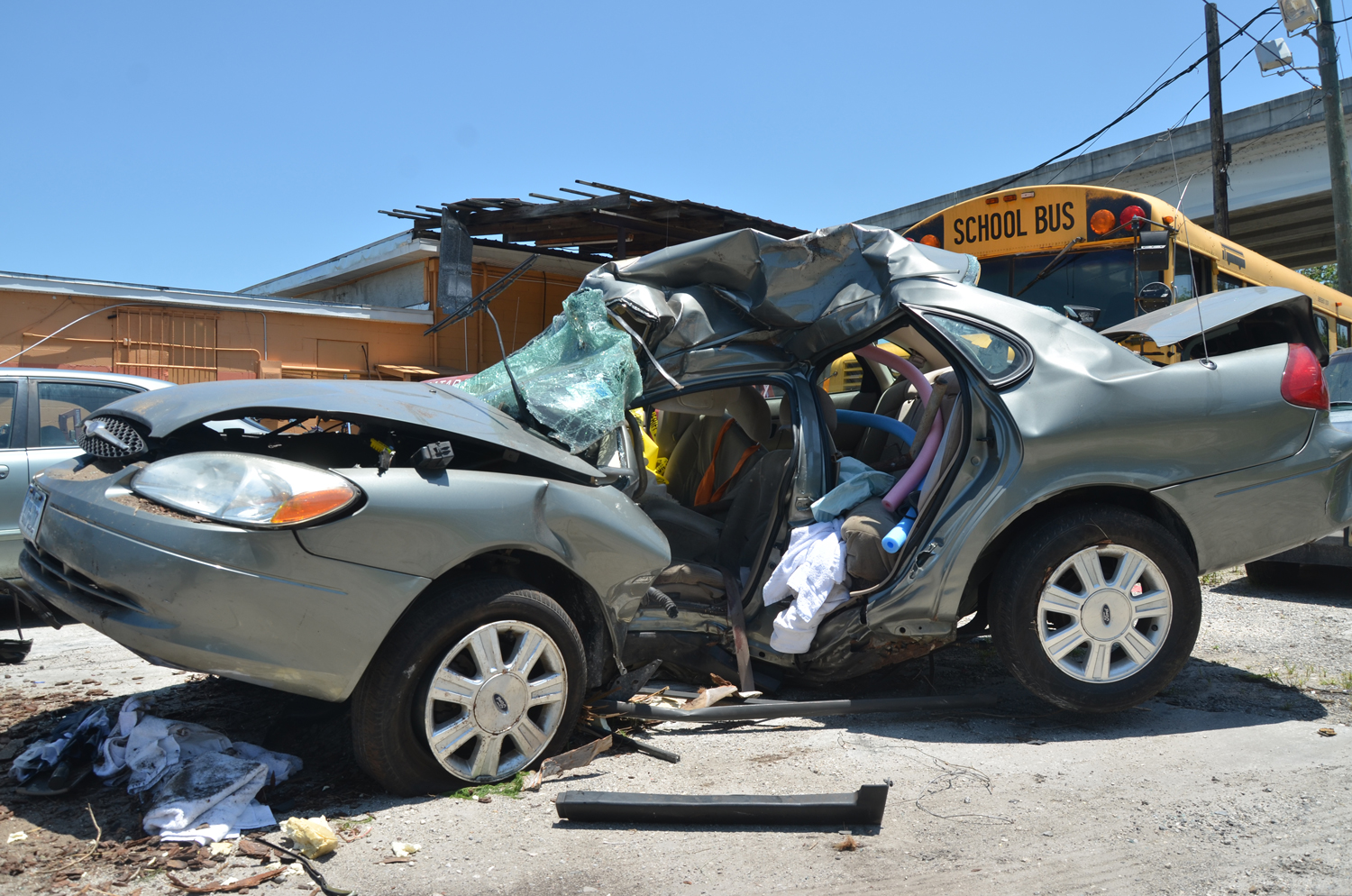 The Ford Taurus after it was towed from the scene. The tree it struck left & Mark Weins 56 Is Killed in Single-Car Wreck on A1A Overnight ... markmcfarlin.com