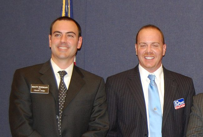 hen-judicial candidates Matthew Foxman, left, and Scott DuPont in an appearance at a Bunnell forum during their first campaign in 2010. Both won. DuPont subsequently ignored Foxman's warnings about acting inappropriately in his second election campaign in 2016, warnings the Judicial Qualifications Commission cited among its evidence to recommend DuPont's removal, and warnings DuPont ignored. (© FlaglerLive)