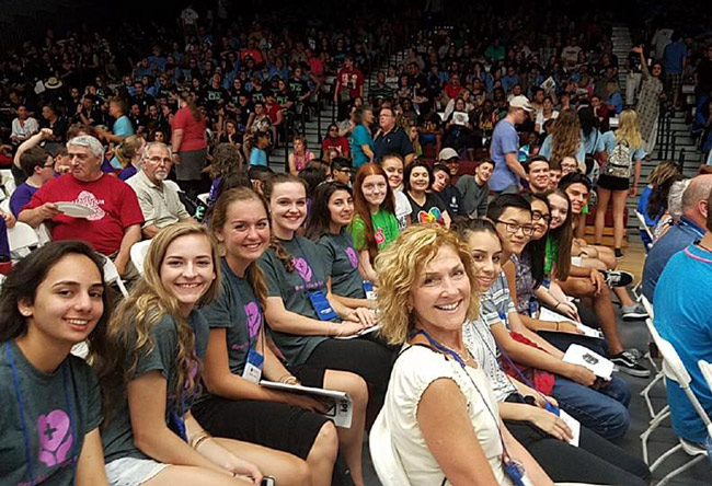 Teacher Diane Tomko in the foreground and the Flagler Palm Coast High School Future Problem Solvers contingent at the closing ceremonies of this year's Future Problem Solving International competition in Lacrosse, Wis., Sunday. (FPS/Facebook)