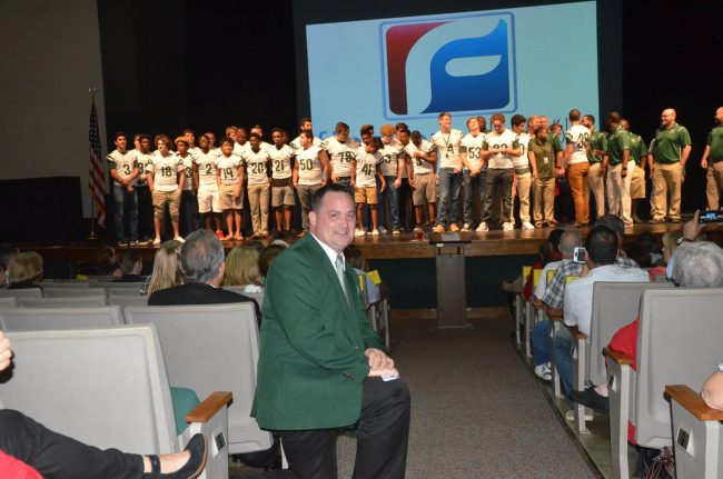 FPC Principal Dusty Sims, with the football team on stage, was all pride Tuesday evening. (© FlaglerLive)