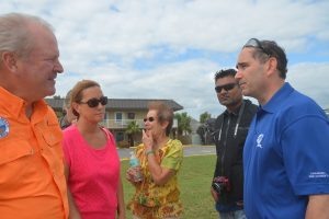 FPL Vice President Robert Gould, right, this morning in Flagler Beach, speaking with, from left, Flagler Beach City Manager Larry Newsom, Flagler Beach Mayor Linda Provencher, and Flagler Beach City Commission Chairman Jane Mealy. The man next to Gould was not identified. Click on the image for larger view. (c FlaglerLive)