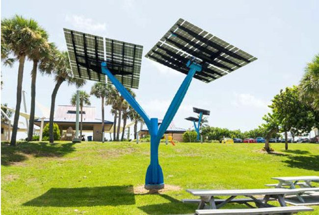 FPL would install five such solar-paneled 'trees,' like the one above at a park in Boynton Beach, at Central Park in Town Center, among other solar installations. (FPL)