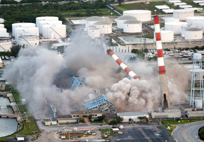 Florida Power & Light in July demolished its 1960s-era Port Everglades Power Plant in Hollywood, Fla., to make way for a new, clean energy center powered by  natural gas. The demolition of four 350-foot, candy-cane-striped stacks and four 7,500-ton boilers – a staple of South Florida's skyline for more than 50 years – occurred shortly after sunrise, launching a new era for FPL customers and South Florida. (FPL)