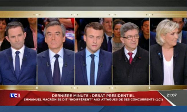 The five candidates for the French presidency in a debate last night, five weeks from the election round. From left, Benoît Hamon, François Fillon, Emmanuel Macron, Jean-Luc Mélenchon and Marine Le Pen. (© FlaglerLive)