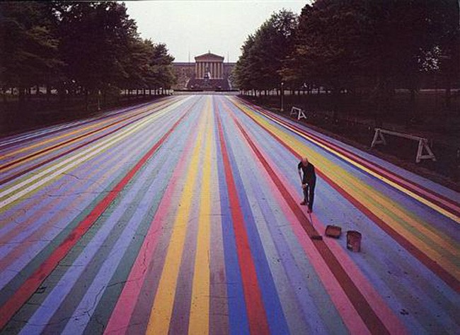 From WikiArt: Soya alkyd paint on asphalt, in front of the Philadelphia Museum of Art. 414 feet long, it was the world's largest artwork at the time. It was featured in the June 16, 1972 issue of Life Magazine. Destroyed in the meantime.