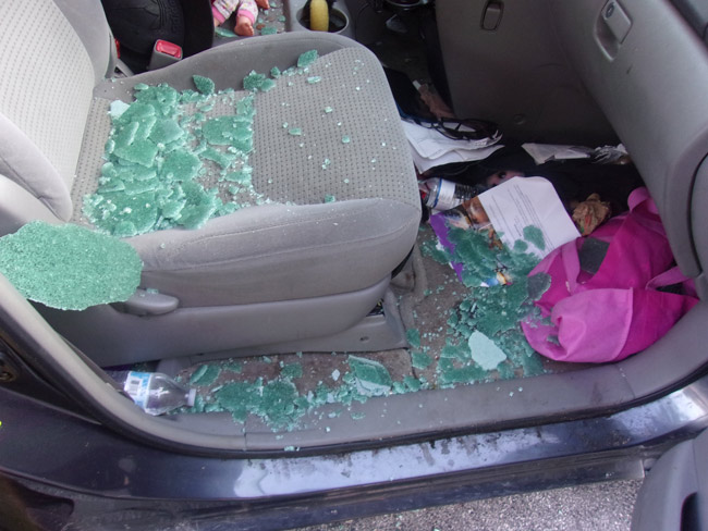 One of the three cars burglarized at the city's pool Tuesday evening, its driver's side window's shards evidence of the break-in. (FCSO)