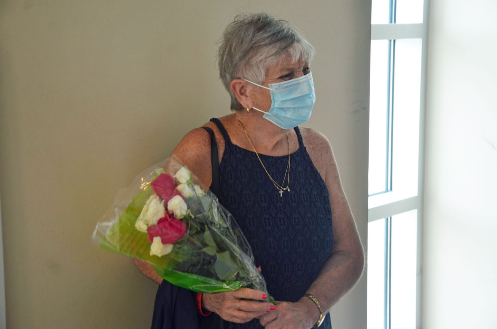 A friend of the Deangelis family sought to give the Deangelis parents flowers at today's hearing, but she was not allowed into the courtroom due to Covid-19 restrictions. The Deangelis parents also were not in the courtroom. They attended by zoom. (© FlaglerLive)