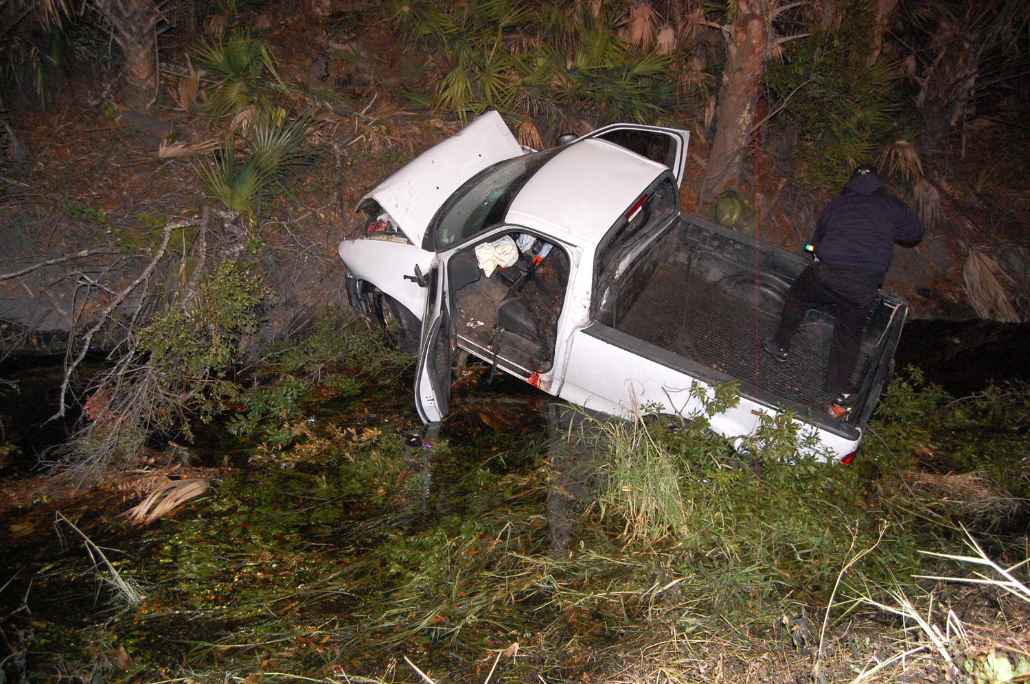 The 2003 Ford F150 XL literally flew across the length of the canal and hit the embankment on the other side of the road before crashing down toward the water. (© FlaglerLive)