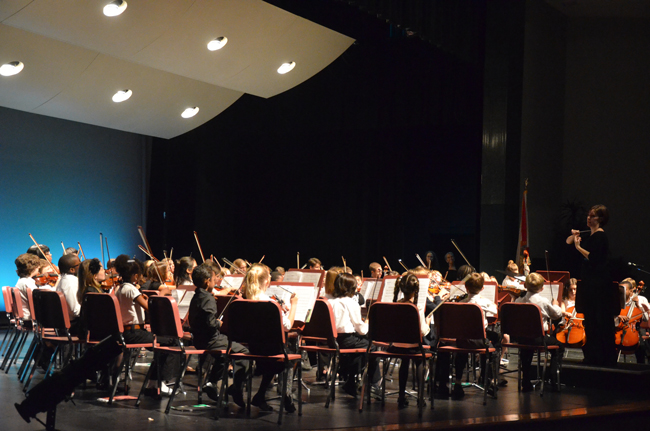 One of the Flagler Youth Orchestra's ensembles performing at last December's concert at the Flagler Auditorium, under the direction of Maggie Snively. (© FlaglerLive)