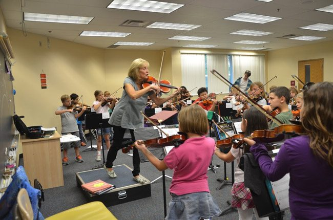 Flagler Youth Orchestra Artistic Director Sue Cryan during rehearsals last week for tonight's concert at the Flagler Auditorium, which will feature all the ensembles and all 375-some musicians of the Youth Orchestra. See details below. (© FlaglerLive)