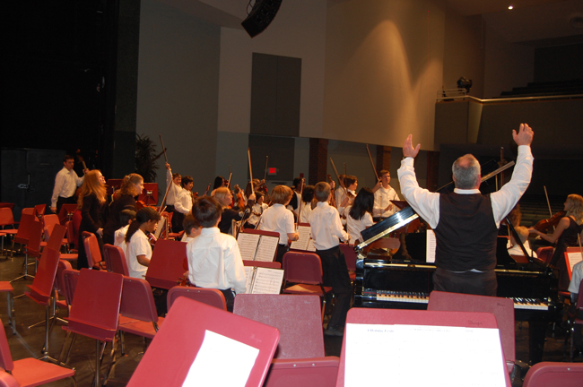 conductor jonathan may in rehearsal with the flagler youth orchestra, December 2009 (© FlaglerLive)