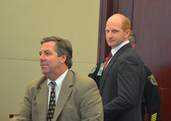 Grant Gieger, right, with his attorney, William Bookhammer, three hours before he heard the verdict against him. (© FlaglerLive)
