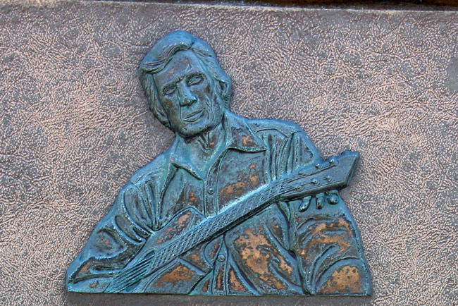 Gamble Rogers, in a detail from the plaque in his honor at Gamble Rogers State Recreation Area at Flagler Beach. The plaque would be the only remnant to his memory if the area's name is changed in accordance with the city's wishes. (© FlaglerLive)