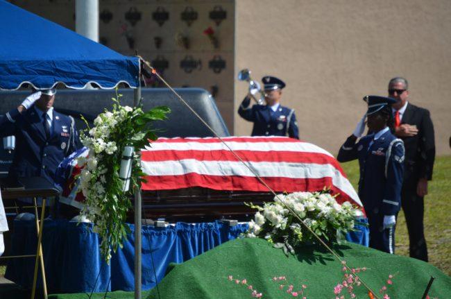 Military honors during the burial ceremony this morning. Click on the image for larger view.  (© FlaglerLive)
