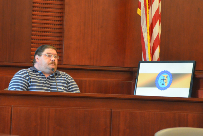Gary Hodges testifying on his own behalf this morning. (c FlaglerLive)