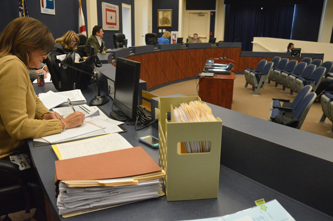The stack of applicants for superintendent, next to School Board Attorney Kristy Gavin, was largely unruffled Thursday as the board focused on a short-list of names it narrowed down to three. (© FlaglerLive)