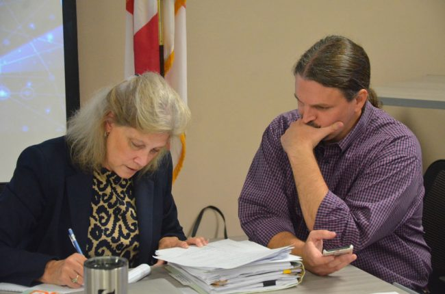 Then it was down to number-crunching between Sprouse and School Board Attorney Kristy Gavin. (© FlaglerLive)