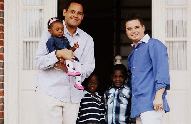 Casanova and Daniel Nurse stand with children Ava Rose, 2, and Neijal and Cameron, both 4, whom they adopted from Florida's foster care system. (Crystal Keith)