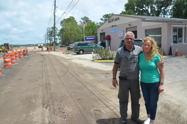 'It hasn't sunk in yet,' Colleen Ajram said Wednesday as she and her husband Gus reflected on the settlement with Palm Coast outside of GEA Auto on Bulldog Drive. (© FlaglerLive)