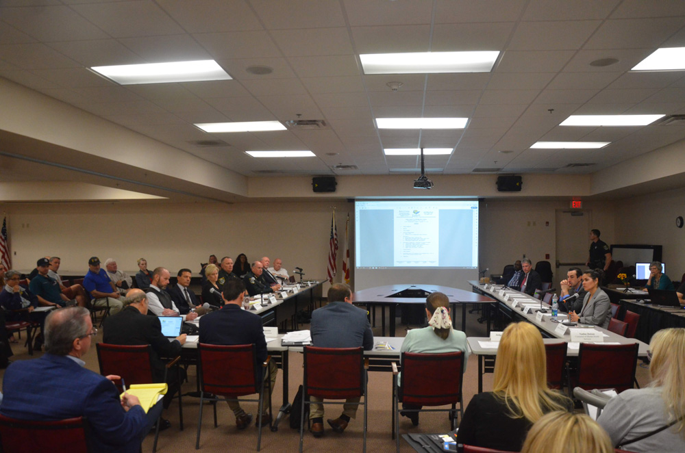 Trish Giaccone, nearest on right at the table, heads Flagler County's Family Life Center. She addressing the Publci Safety Coordinating Council, of which she is a member, in a meeting last year. (© FlaglerLive)