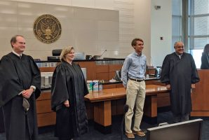 Flagler Palm Coast High School junior Sean Gilliam with, from left, District Judges Timothy Corrigan, Marcia Morales Howard and and Brian Davis. Corrigan and Morales were appointed by President George W. Bush, Davis by President Obama. (Allison Elledge)