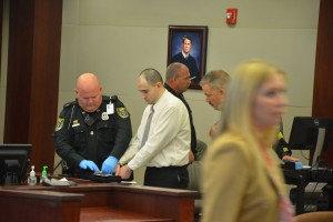 Verdone being fingerprinted after the verdict as Assistant State Attorney Christy Opsahl walks out to get congratulated by her colleagues. Click on the image for larger view. (© FlaglerLive)