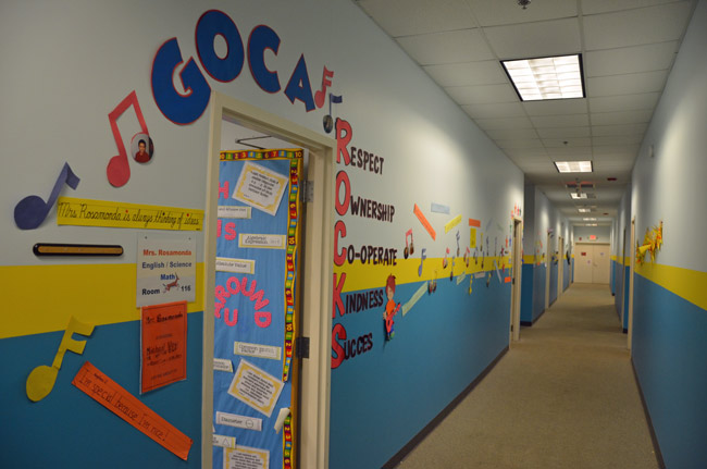 Global Outreach Charter Academy had very quickly developed the lived-in feel of a school, despite its odd location at the Flagler County Airport. The empty look of one of its corridors Tuesday evening was to be prematurely permanent. (© FlaglerLive)