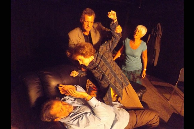 """Veronica (Bobbi Fouts) attacks her husband Michael (Peter Gutierrez) as Alan (Eric Bohus) and Annette (Sue Pope) react in the City Repertory Theatre production of """"God of Carnage."""" The dark comedy by Yasmina Reza runs Oct. 30 through Nov. 8 at the Palm Coast theater."""