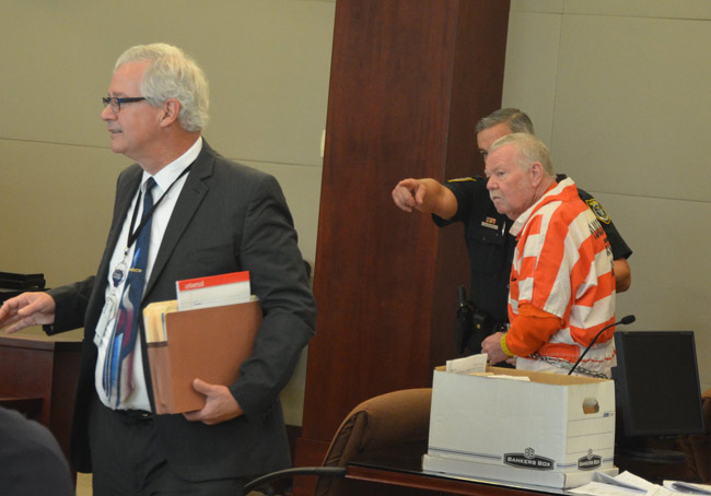 Bobby Earl Gore, right, in court in August, with his attorney, Ray Warren. (© FlaglerLive)