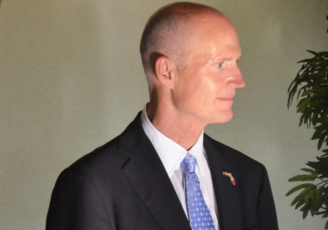 Gov. Rick Scott is not letting go of a weedy obsession. (© FlaglerLive)