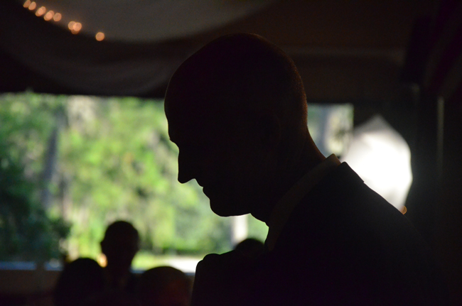 The battle over the Florida governorship in 2014 will focus the eyes of the nation on the state yet again. Rick Scott's silhouette was in evidence at a local GOP dinner in July. (© FlaglerLive)