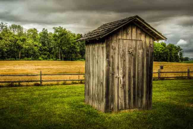 Gov. Rick Scott closes the outhouse of suspicion. (Todd Petrie)