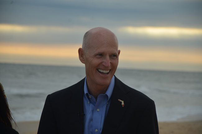 Gov. Rick Scott, who stopped in Flagler last week to announce some emergency spending on beach repairs, has been touring the state to preview parts of his budget. (c FlaglerLive)