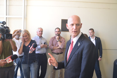 Gov. Rick Scott during a visit to Flagler in October, at the county's Emergency Operations Center. (© FlaglerLive)
