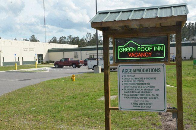 flagler jail green roof inn sign