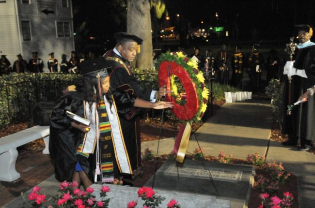 The service of consecration closed with the traditional Candlelight Wreath Laying Ceremony in front of the burial site of Dr. Mary McLeod Bethune. Doing the honors: the 65th Miss B-CU Jacqualyn Townsend, and Interim President Hubert Grimes. (BCU)