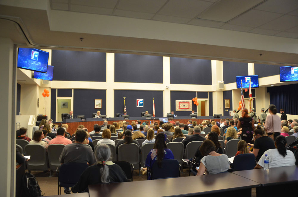 The good days: the school board's last in-person meeting, last February, which drew a capacity crowd. It'll be much different when the school board starts meeting again in person next month. The county commission holds its meetings in the same space. (© FlaglerLive)