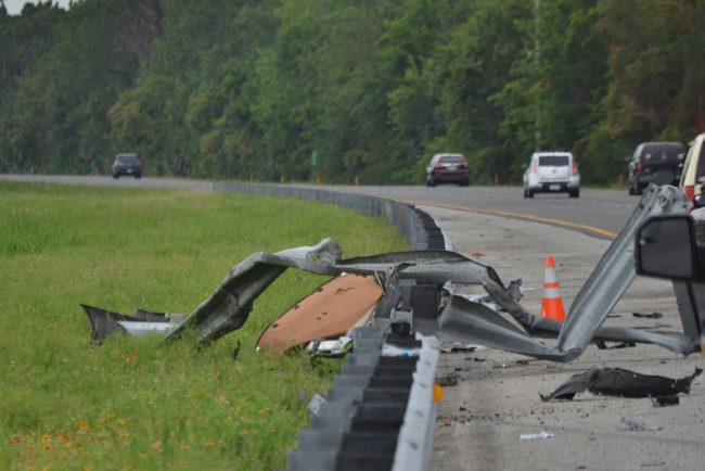 The Honda Civic crashed through the guardrail. Click on the image for larger view. (© FlaglerLive)