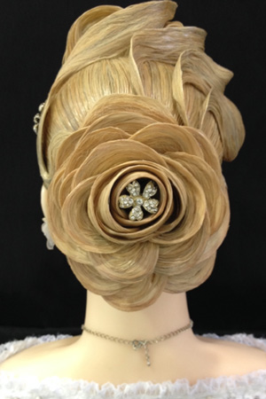 The hair design that won Mania Saman a first0-place award in the bridal up-do styling contest at the Barristar Student Symposium in Kissimmee last March.