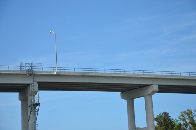The Hammock Dunes Bridge was completed in 1988. It's been paid off for 10 years, but still collects $1.6 million in tolls annually. (© FlaglerLive)
