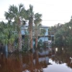 A flooded property in the Hammock in 2016, in the aftermath of Hurricane Matthew, whose effects were limited to tropical storm conditions onshore. (© FlaglerLive)