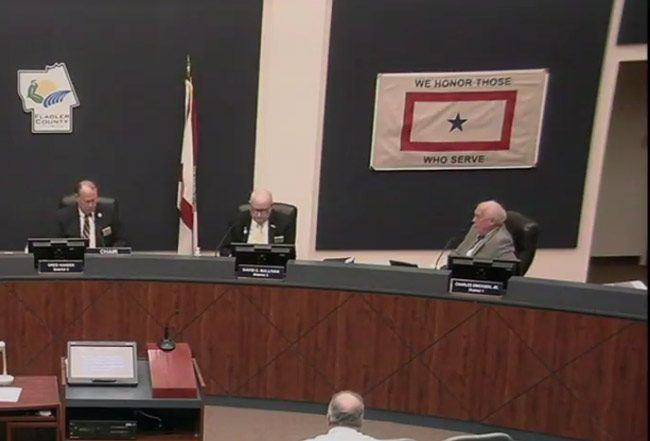 From left, County Commissioners Greg Hansen, Dave Sullivan and Charlie Ericksen Monday morning voted to ban medical marijuana dispensaries in unincorporated Flagler County. (© FlaglerLive via Flagler County TV)