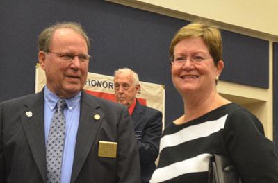 Greg and Linda Hansen. Commissioner Charlie Ericksen is in the background. (© FlaglerLive)