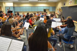 The Harmony Chamber Orchestra in rehearsal Wednesday at Indian Trails Middle School. Click on the image for larger view. (© FlaglerLive)
